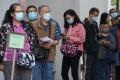 People queue up for Covid-19 jabs at Hong Kong's Sha Tin Community Vaccination Centre. Photo: Felix Wong
