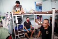 Filipino seafarers stranded amid the coronavirus pandemic rest inside a dormitory in Manila, Philippines, on April 29, 2020. Photo: EPA-EFE