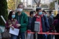 People line up to receive a Sinovac jab in Hong Kong on February 26. The Chinese vaccine is not accredited in much of the world, making it unlikely to be accepted for any international vaccine passport for travel to the US and Europe. Photo: EPA-EFE