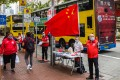 China's national flag is displayed at a stall where residents can sign in favour of changes to the local electoral system in Hong Kong on March 11. Photo: AFP
