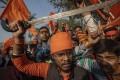 Hindu hardliners, one brandishing a sword, chant slogans against Muslim communities during a rally in 2018 in Uttar Pradesh. Photo: AP