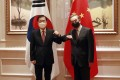 South Korean Foreign Minister Chung Eui-yong, left, and Chinese Foreign Minister Wang Yi bump elbows in Xiamen. Photo: AP