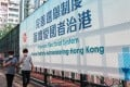 A government banner touts sweeping changes to Hong Kong's electoral system approved last week in Beijing. Photo: K. Y. Cheng