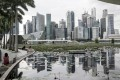 The skyline of the financial district reflected in a lotus pond at the ArtScience Museum in Singapore on 17 November 2020. Photo: EPA-EFE