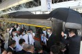 A funeral was held for train driver Yuan Chun-hsiu on Tuesday and his family took his ashes by train to his hometown Taichung. Photo: CNA