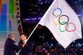 During the closing ceremony of the 2018 Winter Games in South Korea, Thomas Bach, the president of the International Olympic Committee (left), passed the Olympic flag in 2018 to Chen Jining, the mayor of Beijing,  which will host the 2022 Winter Games. Photo: AFP via Getty Images/TNS)