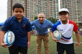 Integrated Brilliant Education Limited students Aris Gurung, school CEO and cofounder Manoj Dhar and student Abhi Limbu at a Hong Kong Rugby Union rugby fun day at King's Park, Jordan in April. Photo: SCMP / May Tse