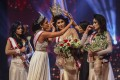 Mrs World Caroline Jurie removes the crown of Mrs Sri Lanka winner Pushpika de Silva during a beauty pageant for married women in Colombo on Sunday. Photo: AFP
