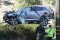 A crane is used to lift a vehicle following a rollover accident involving golfer Tiger Woods in the Los Angeles area in February. Photo: AP