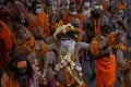 Naga Sadhus, or Hindu holy men, participate in the procession for taking a dip in the River Ganges during the Kumbh Mela festival, to which crowds are flocking despite India's surge in Covid-19 cases. Photo: Reuters