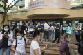 People queue up to receive a coronavirus vaccine at Hong Kong Central Library. Photo: Edmond So