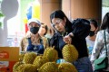 A vendor sells durian fruits at a street stall in Bangkok in May last year. Photo: AFP