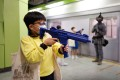 Children play with toy guns during a police college open day earlier this week. Photo: Reuters