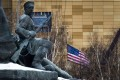 The US flag is seen at the country's embassy in Moscow, behind a monument to the Workers of 1905 Revolution. Photo: AP