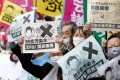 People rally in front of the prime minister's office in Tokyo this month against the Japanese government's decision to release treated radioactive water from the crippled Fukushima Daiichi nuclear power plant into the sea. Photo: Kyodo