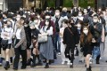 People are seen shopping in Tokyo's Shibuya area. The city is battling a surge in coronavirus infections amid concerns about mutations and lagging vaccination rates. Photo: Kyodo