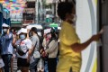 People stand in line for a swab test at a temporary Covid-19 testing site in Bangkok on Monday. Photo: Bloomberg