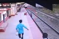 A still from CCTV footage showing railway worker Mayur Shelke's dramatic rescue of a 6-year-old boy who fell onto the tracks at Vangani station in India. Photo: Twitter