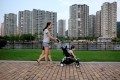 People walk past a residential property development by Agile Property in Zhongshan, Guangdong. Photo: Reuters