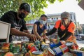 People arrange grocery items to be given away at the Maginhawa Community Pantry in Quezon City, started by Ana Patricia Non. Photo: Xinhua