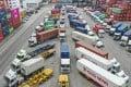Trucks queue at the Hong Kong Container Terminal. Photo: Roy Issa