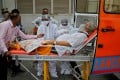 A patient wearing an oxygen mask is wheeled inside a Covid-19 hospital for treatment in Ahmedabad. Photo: Reuters