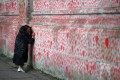 A person writes a message on the National Covid Memorial Wall in London, for those who have died in the UK. File photo: Reuters