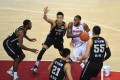 Sonny Weems, of the Guangdong Southern Tigers, dribbles through a crowd of Liaoning Flying Leopards players in game one of the 2020-21 Chinese Basketball Association finals. Photo: Xinhua