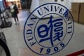 A Fudan University sign is seen on the campus in Shanghai in December 2019. Photo: AFP