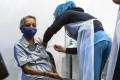 An elderly woman receives a Pfizer-BioNTech coronavirus vaccine shot in Malaysia. Photo: EPA-EFE
