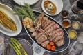The Upper Deck's 21- to 30-day dry-aged USDA porterhouse with side dishes. Photo: handout