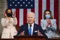 US President Joe Biden addresses a joint session of Congress, flanked by Vice-President Kamala Harris and House Speaker Nancy Pelosi. Photo: AP