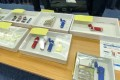 Police officers display the seized stun guns. Photo: Handout