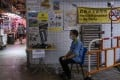 In wet markets like this, swimming pools, parks and on the streets in Hong Kong is an army of underemployed and elderly cleaners and sweepers. They are the victims of colonial officials' opposition to free compulsory education, which left those from poor families semi-literate at best. Photo: Vernon Yuen/NurPhoto via Getty Images
