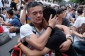 Same-sex activists hug outside the parliament in Taipei in 2017 as they celebrate the landmark decision paving the way for the island to become the first place in Asia to legalise gay marriage. The rest of China has yet to follow suit, and prejudice against same-sex couples persists in some quarters. Photo: AFP