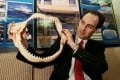 South African consul-general Michael Farr holding shark jaws at the centre of the Natal Sharks Board. The Board's nets are used in Hong Kong to keep sharks away. Photo: CWH