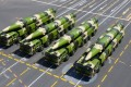 A Chinese rocket force brigade practised the fast transfer of DF-26 ballistic missiles to another location to launch a second wave of missiles. Photo: Xinhua