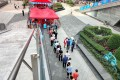 People queue to receive nucleic acid tests for Covid-19 in Shenzhen after an outbreak in the southern province of Guangdong. Photo: AFP