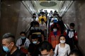 """Subway commuters during rush hour in Beijing on June 2. Ground down by the sapping realities of modern city life, China's youth are """"lying flat"""", the latest buzzword for those tapping out of a culture of endless work with little reward. Photo: AFP"""