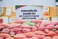 """Methamphetamine pills known locally as """"ya ba"""" on display in Thailand in 2020 to mark the United Nations' """"International Day against Drug Abuse and Illicit Trafficking"""". Photo: AFP"""