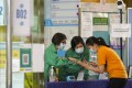 A person arrives for their BioNTech vaccination at Sun Yat Sen Memorial Park Sports Centre on Friday. Photo: Winson Wong