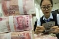 Chinese banks extended 1.5 trillion yuan (US$235 billion) in new yuan loans in May, up from 1.47 trillion yuan in April and beating analysts' expectations of 1.41 trillion yuan, according to data released by the People's Bank of China (PBOC) on Thursday. Photo: AP