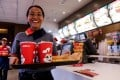 A Jollibee worker serves a meal at an outlet in Pasig City. Photo: SCMP/Jansen Romero