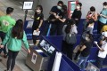 Residents queue for BioNTech vaccinations at Sun Yat Sen Memorial Park Sports Centre on Saturday. Photo: Jonathan Wong