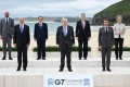Leaders pose at the start of the G7 summit in Carbis Bay, Cornwall on Friday. Photo: AFP