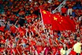 Chinese football fans cheer on the team in a Fifa World Cup 2018 qualifier against Uzbekistan in Wuhan in 2017. Photo: Reuters