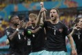 Marko Arnautovic (No 7) of Austria celebrates after scoring against North Macedonia in their opening match of Euro 2020. Photo: EPA