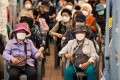 Elderly residents wait to receive a dose of the Pfizer-BioNTech vaccine in Seoul. Photo: Bloomberg