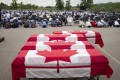 Mourners and supporters gather for a public funeral for members of the Afzaal family in London, Canada. Photo: AFP