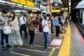 Passengers wait for a train at Shinjuku station in Tokyo. Photo: AFP